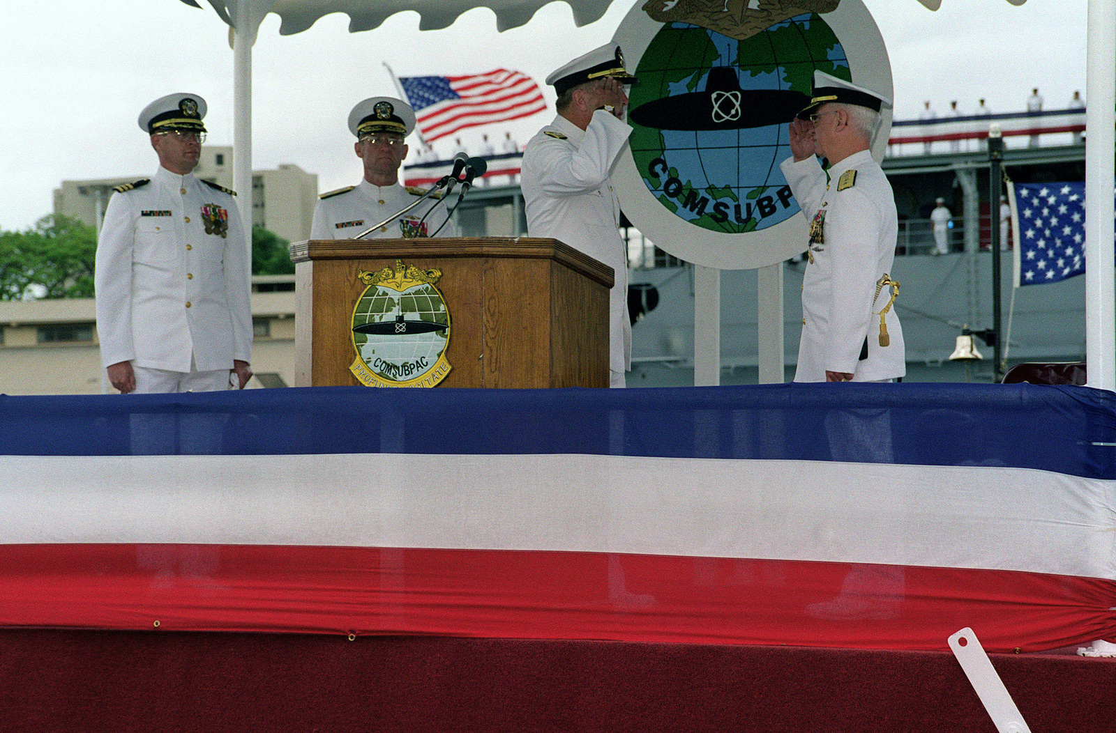 """US Navy Rear Admiral (Upper Half) (RADM) Albert H. Konetzni Jr. relieves RADM (UH) Winford G. """"Jerry"""" Ellis, USN, as Commander Submarine Force Pacific during Change of Command Ceremony held aboard the attack submarine USS BREMERTON (SSN 698), Pearl Harbor, Hawaii, 8 May 1998. In background is the presiding officer, Admiral Archie R. Clemins, USN, Commander-in-CHIEF US Pacific Fleet"""