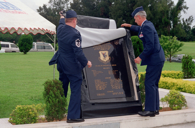 US Air Force Brigadier General John R. Baker, Commander 18th Wing, and CHIEF MASTER Sergeant Robert Stivers, SENIOR Enlisted Advisor, reveal the 18th Wing memorial statue during a retreat ceremony at Kadena Air Base, Japan. The memorial honors members who have died while assigned to the 18th Wing