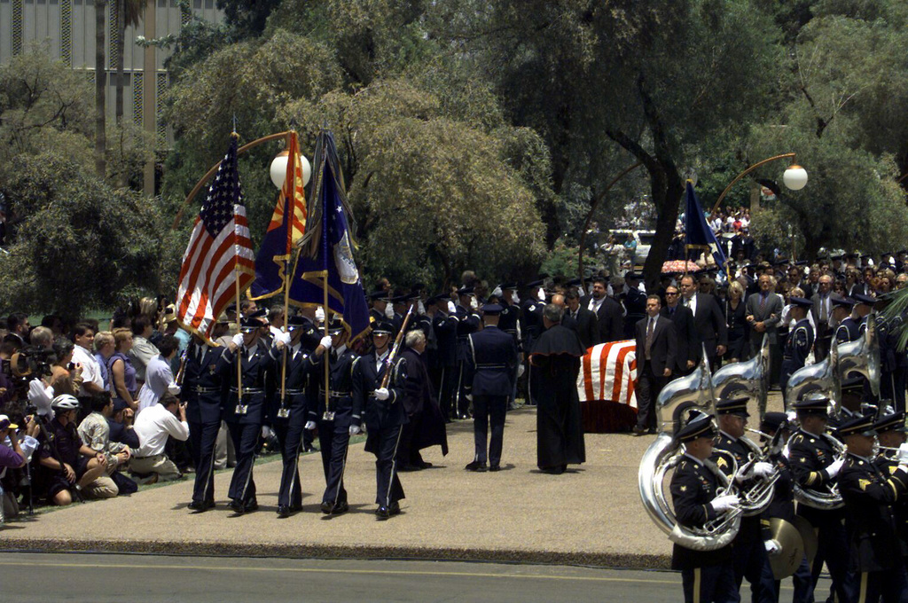 The 36th US Army Band of Fort Huachuca, Arizona, and the US Air Force Honor Guard marches towards Gammage Auditorium, Tempe, AZ, followed by the funeral precession for the late Senator and former US Air Force Major General Barry M. Goldwater