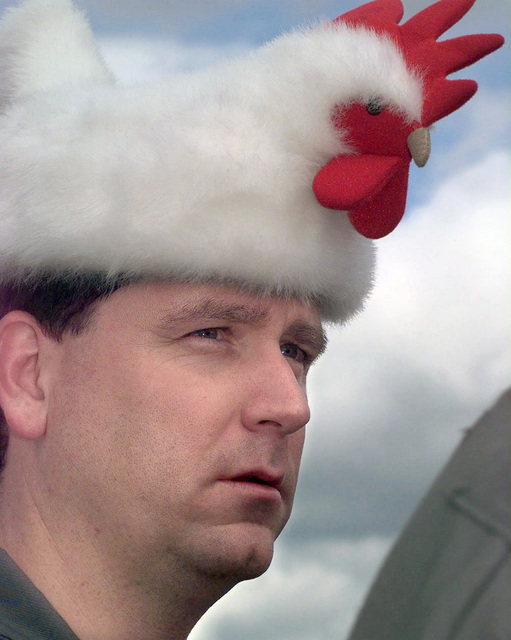 US Air Force (USAF) First Lieutenant (1LT) Greg Yost, 446th Aerial Evacuation Squadron (AES), OFallon Air Force Base (AFB), Illinois (IL), wears his traditional Rodeo (Chicken) Hat for good luck at the start of the USAF Air Mobility Command (AMC) sponsored Rodeo 98 airlift competition at McChord Air Force Base (AFB), Washington (WA)