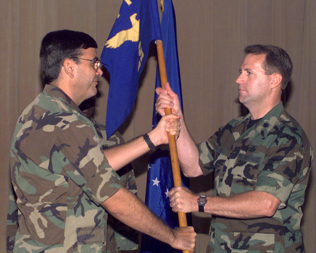At the Change of Command ceremony on 22 June 1998, Lieutenant Colonel (LCOL) Lieutenant Colonel (LCOL) passes the unit standard to LCOL James Kolling, who assumes command of the 12th Communications Squadron. LCOL Kolling arrives at Randolph Air Force Base, after completing SENIOR Service School as part of a National Security Fellowship at Harvard Universitys John F. Kennedy School of Government