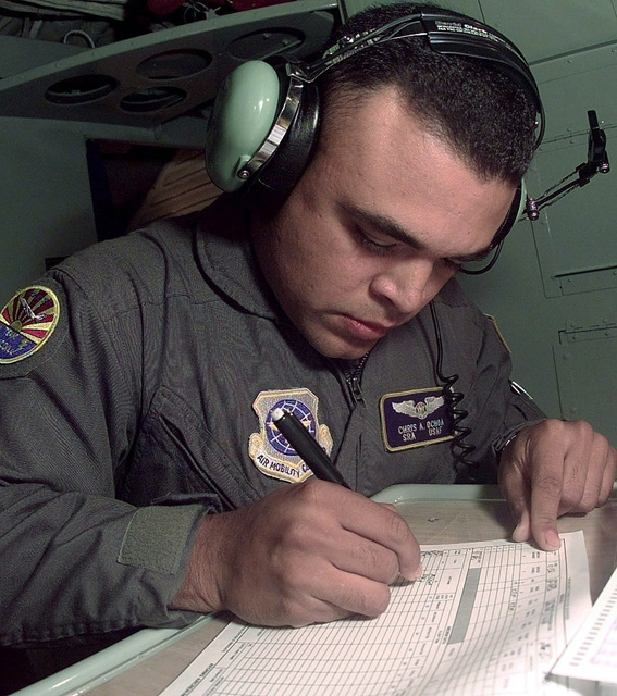 US Air Force (USAF) SENIOR AIRMAN (SRA) Chris Ochoa, KC-135 Stratotanker Boom Operator, 91st Air Refueling Squadron (ARS), MacDill Air Force Base (AFB), Florida (FL), completes the USAF Aircrew Data form after his final timed aerial refueling mission during the aerial refueling competition portion of the USAF Air Mobility Command (AMC) sponsored Rodeo 98 airlift competition at McChord AFB, Washington (WA)