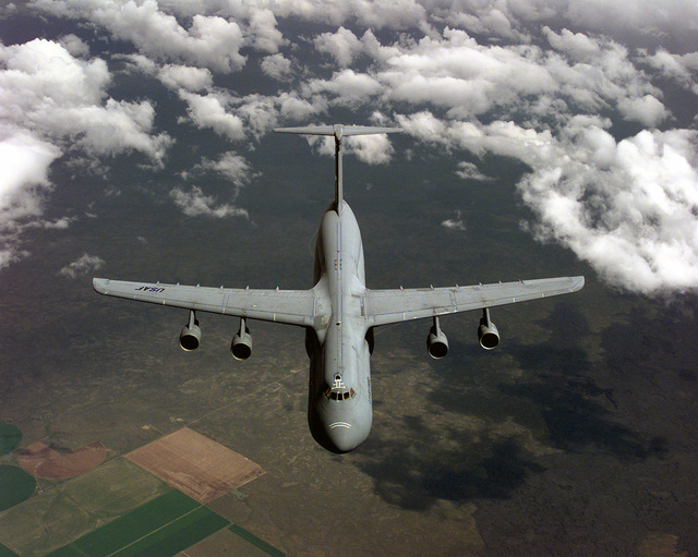 A US Air Force (USAF) 97th Air Mobility Wing (AMW), Altus Air Force Base (AFB), Oklahoma (OK), C-5B Galaxy cargo aircraft remains on station after breaking away from an Air Force Reserve Command (AFRC), 72nd Air Refueling Squadron (ARS), 434th Air Refueling Wing (ARW), Grissom Air Reserve Base (ARB), Indiana (IN), KC-135R at the end of an aerial refueling mission during the aerial refueling competition portion of the USAF Air Mobility Command (AMC) sponsored Rodeo 98 airlift competition at McChord AFB, Washington (WA)