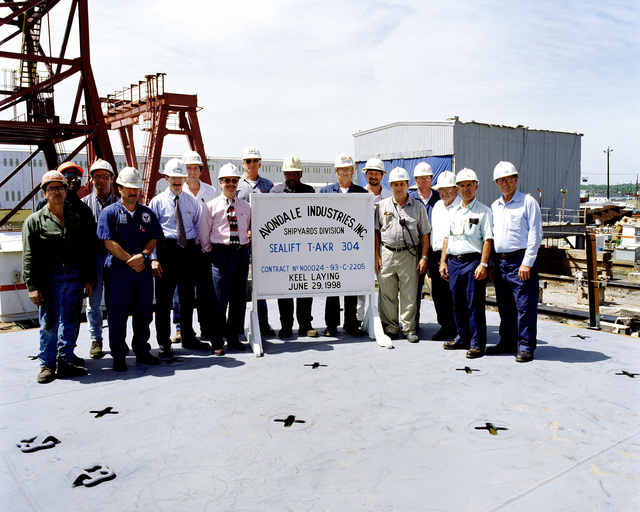 Official keel laying of the Military Sealift (MSC) strategic heavy lift ship USNS PILLARU (T-AKR 304) at the Avondale Shipyard. Left to right: Lenin Fernandez, Avondale Inc.; Richard Allen, Avondale; Joey Forest, Avondale; Don Stewart MSC; Rob Kuehnel, Avondale; Chad Hawkins, MSC; Carey Agregaard, Avondale; James Person, MSC; Joe Harry, Avondale; John Lusk, MSC; Mark Sealer, MacGregor Inc.; Larry Broadlee, Avondale; Aldean Chapli, MSC; V.J. Rome, Avondale; Douglas LeBlanc, Avondale; Norman Brown, Avondale Industries, Inc