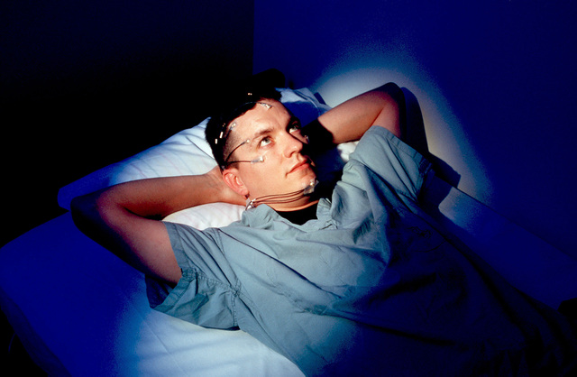 US Air Force SENIOR AIRMAN Michael Lindly gets wired for sleep during an experiment at Brooks Air Force Base, Texas. Researchers there are helping airmen fight fatigue and get a better night's sleep. This image was used in the July 1998 issue of AIRMAN Magazine