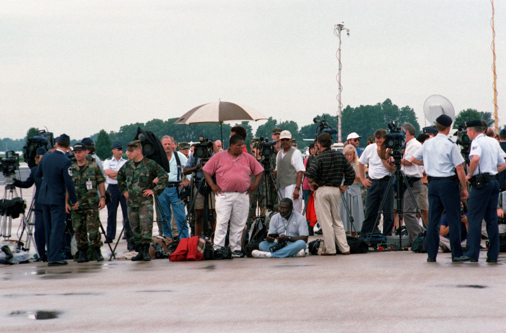 Members of the media from Scott, AFB, Air Force News and other organizations wait for the remains of USAF Lieutenant Michael Blassie, to arrive at Scott AFB, Illinois. The remains of Lieutenant Blassie are being returned to his family after lying unidentified for fourteen years in the Tomb of the Unknowns