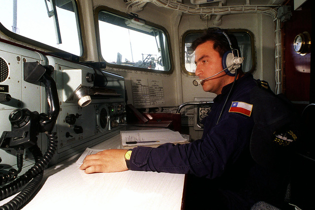 On the Chilean frigate CNS CONDELL (FFH 6), a radioman monitors communications prior to leave for sea exercises during RIMPAC '98