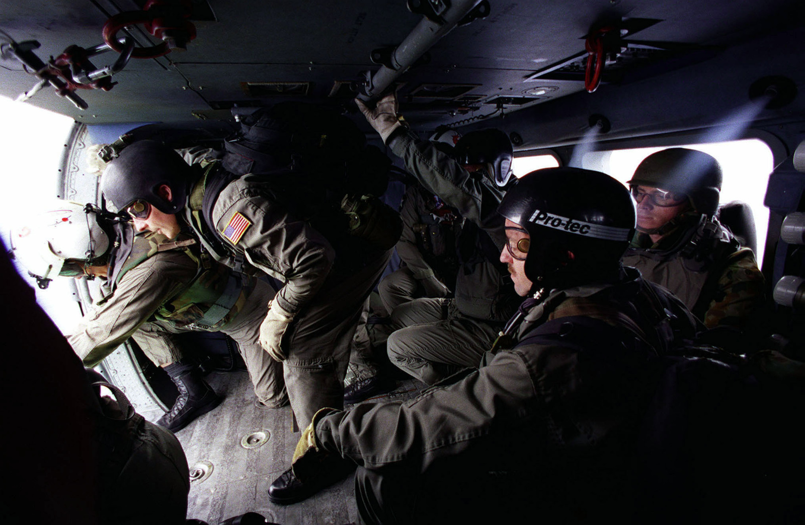 Explosive Ordnance Disposal (EOD) technicians from EOD Mobile Unit Two, Whidby Island, Washington prepare to fastrope down from a Navy helicopter to a Canadian ship during the exercise RIMPAC 98