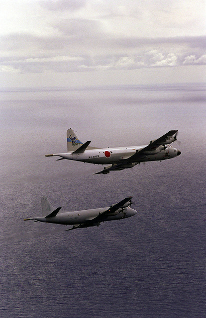 A Japanese P-3C Orion from Detachment 33, Japan Maritine Self Defense Force, Atsugi and an American P-3C from the Skinny Dragons of Patrol Squadron 4, Naval Air Station Barber's Point, Hawaii, part of the bilateral force during the exercise RIMPAC '98, patrol the ocean near Hawaii