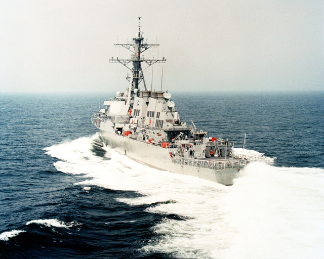 A port quarter view of the guided missile destroyer USS DONALD COOK (DDG 75) underway off the coast of New England