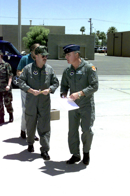 Acting Secretary of the Air Force F. Whitten Peters (Left) visited Luke Air Force Base (AFB), Arizona for a better understanding of the issues involved in the renewal of the Barry M. Goldwater range. F. Whitten Peters and Brigadier General Carroll H. Chandler (Right), 56th Fighter Wing commander, walk out to the flightline at Luke AFB for a flight over the Goldwater range