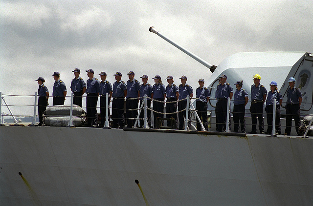 """Sailors aboard the Halifax class Canadian frigate HMCS VANCOUVER (FFH 331), """"man the rails"""" as the ship leaves Naval Station Pearl Harbor for sea exercises during RIMPAC 98"""