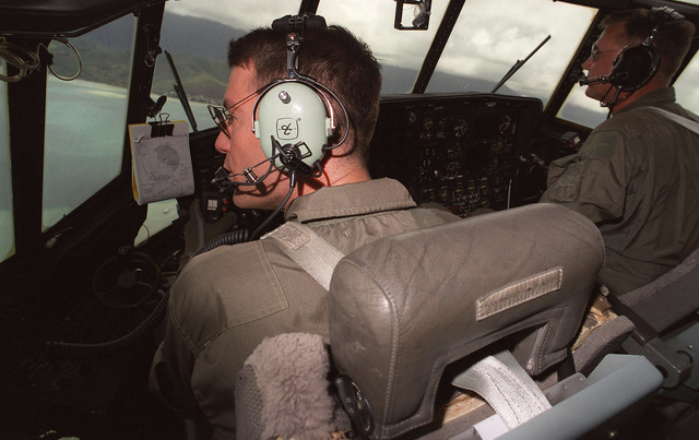 USMC MAJ Brad James (left) and MAJ Ted Wenry (right) of the Marine Aerial Refueler Transport Squadron 234 (VMGR-234), NAS Forth Worth, Texas, prepare to land their KC-130 during exercise RIMPAC 98