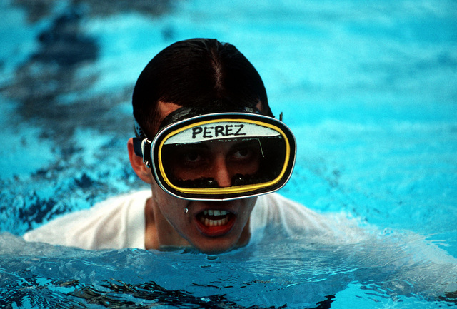 Aching arms and legs don't deter this trainee from spending hours learning swimming techniques. Some techniques to be mastered are buddy breathing, water treading, drown proofing and underwater equipment recovery (Techniques not shown). This image is seen in the August 1998 edition of AIRMAN Magazine