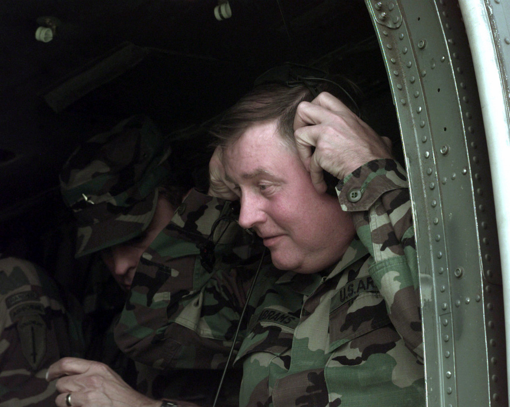 Lieutenant General John Abrams, Comanding General Tradoc, Fort Monroe, Virginia, sits in a UH-47 Blackhawk while attending the VIP day for Exercise RAPID FORCE PROTECTION INITIATIVE (RFPI) Project. RFPI is a field experiment to test new technology for the light forces in the battle field