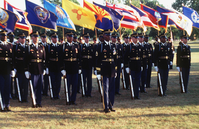 Members of Echo Comapny, the 3rd Infantry (Old Guard), with state and territorial flags, prepare to march in formation at the Fort Meade Twilight Tattoo ceremony