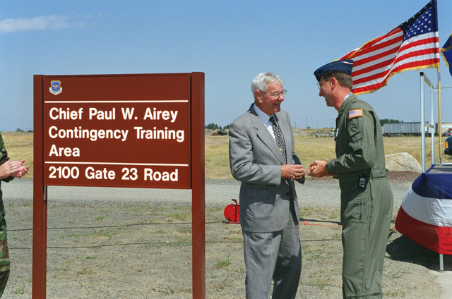 US Air Force Brigadier General Paul W. Essex, Commander, 92nd Air Refueling Wing, Fairchild Air Force Base, Washington, congratulates the first CHIEF MASTER Sergeant of the Air Force, Paul W. Airey, retired, during the dedication ceremony for the CHIEF Paul W. Airey Contigency Training Area