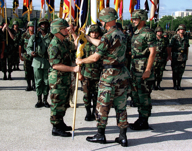US Army General David Bramlett, Commander, Forces Command, passes the Command Flag to Lieutenant General Leon J. LaPorte, incoming III Armored Corps and Fort Hood Commanding General, at the III Armored Corps and Fort Hood Change of Command Ceremony held at Sadowski Field, Fort Hood, Texas