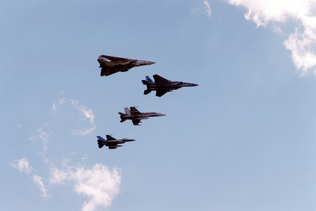Fly-over by US Navy F-14 Tomcat aircraft, US Air Force F-1 Mirage, Canadian Air Force CF-18 Hornet and a USAF F-16 Fighting Falcon aircraft at the Air Force Space Command (AFSPC) change of command ceremony