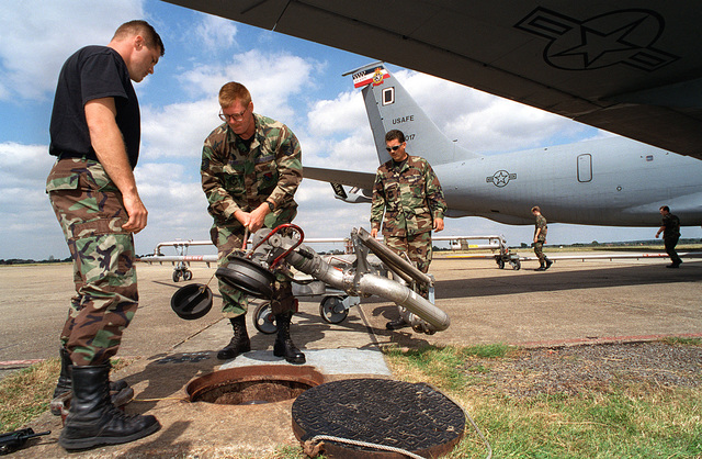 Suffolk County, England. USAF Airmen from the Petroleum, Oil and Lubricant Element (POL), 100th Supply Squadron, 100th Air Refueling Wing, Royal Air Force (RAF) Mildenhall disconnect the pentagram refueling system from the ground source after refueling a KC-135R Stratotanker aircraft