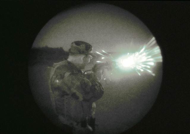 Light enhanced photography fish-eye lens view show an unidentified US Air Force (USAF) Security Police (SP) firing a 7.62mm AK-47 assault rifle, during weapons familiarization training conducted at the Air Mobility Warfare Center, Fort Dix, New Jersey (NJ), during Exercise PHOENIX READINESS 2002