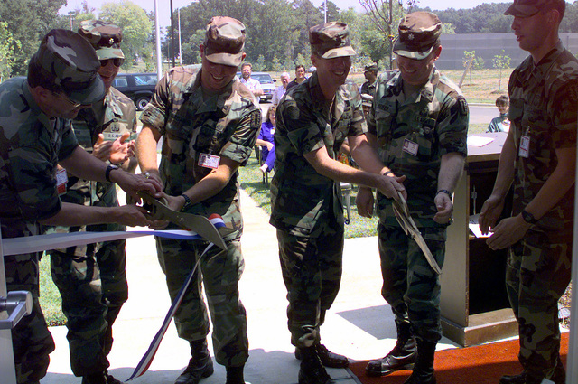 Ribbon cutting ceremony for the new 722nd Explosive Ordnance Disposal facility after the unit moved from Fort McClellan, Alabama when that facility closed. Taking part in the ceremony are (left to right): COL Gregory Potts, Anniston Army Depot commander, LTC Bruce Wright, 184th Ordnance Battalion commander, SPC Burman, CSM Charles Eberhardt, 52nd Ordnance Group, Fort Gillem, Georgia, LTC Bryan Keifer, Deputy Commander, 52nd Ordnance Group, Fort Gillem, Georgia, 1LT David Knapp, 722nd Explosive Ordnance Disposal commander
