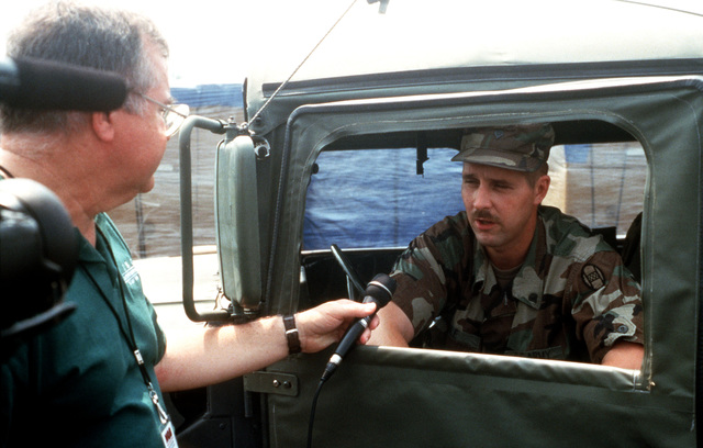 Members of the Visual Information Support Center, Rapid Response Team conduct and interview with a member of the North Carolina Army National Guard, following Hurricane Bonnie