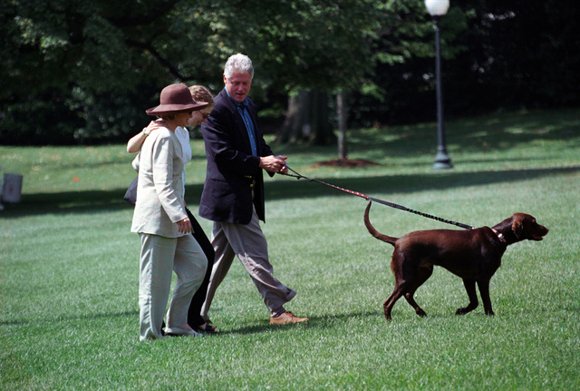 Photograph of President William Jefferson Clinton and First Lady Hillary Rodham Clinton with Buddy the Dog at the White House