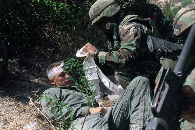 A Navy medical corpsman cares for a downed Marine pilot during Special Operations Training Group (SOTG)