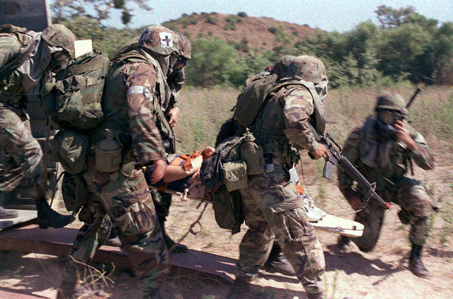 Warriors from the 1ST Battalion 5th Marines extract a wounded victim from a Nuclear Warfare situation during a week of training evolution with the Special Operations Training Group (SOTG) force