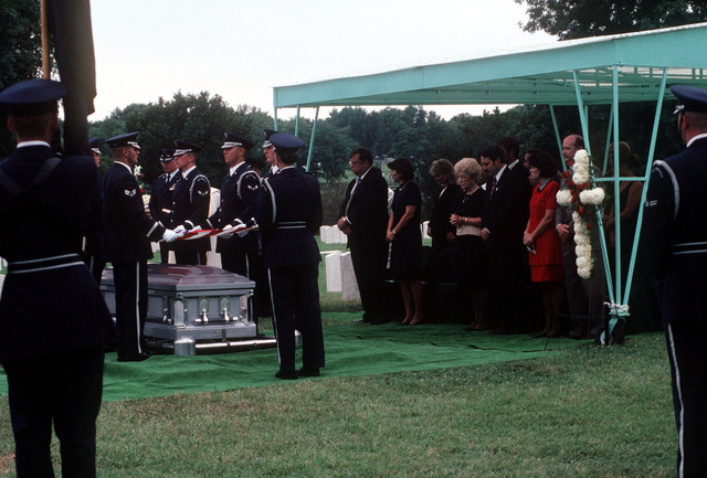 Medium shot of USAF Air Force Color Guard as they carry out the flag folding detail during the burial ceremony for USAF First Lieutenant Michael Blassie at the Jefferson Barracks National Cemetery in St. Louis, Missouri. 1LT Blassie was shot down and killed in South Vietnam on May 11th, 1972. A mix up with dog tags and body identification led the remains listed as Unknown and buried in the tomb of the Unknown Soldier at Arlington National Cemetery (Not shown). Using DNA testing on May 14th, 1998, the remains were indentified as those of 1LT Blassie and services were held in his honor. This image is seen in the September 1998 edition of AIRMAN Magazine
