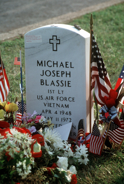 Straight on medium shot of the headstone and final resting place of USAF First Lieutenant Michael Blassie at Jefferson Barracks National Cemetery in St. Louis, Missouri. 1LT Blassie was shot down and killed in South Vietnam on May 11th, 1972. A mix up with dog tags and body identification led the remains listed as Unknown and buried in the tomb of the Unknown Soldier at Arlington National Cemetery (Not shown). Using DNA testing on May 14th, 1998, the remains were indentified as those of 1LT Blassie and services were held in his honor. This image is seen in the September 1998 edition of AIRMAN Magazine