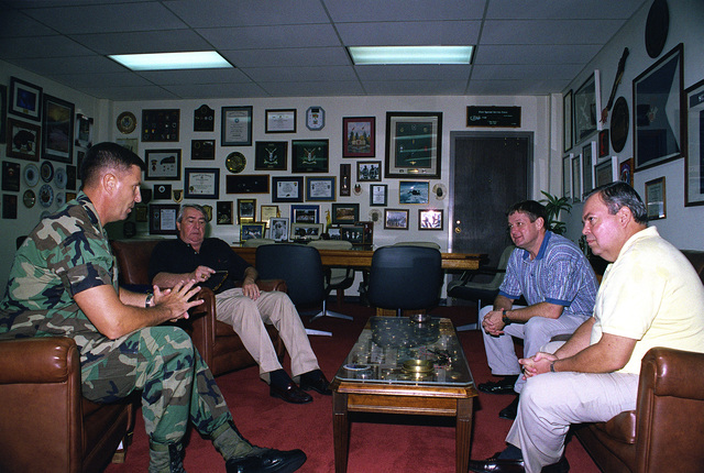 MGEN Philip R. Kensinger, Jr. (left), Commander, U.S. Army South, meet with members of the Civilian Aide to the Secretary of the Army. (From second from left to right): Mr. J. Wallace Schoettelkotte from Winter Park, Florida, Mr. Robert G. Clarke from Randolph Center, Vermont, and Mr. Jose R. Colon from San Patricio, Puerto Rico