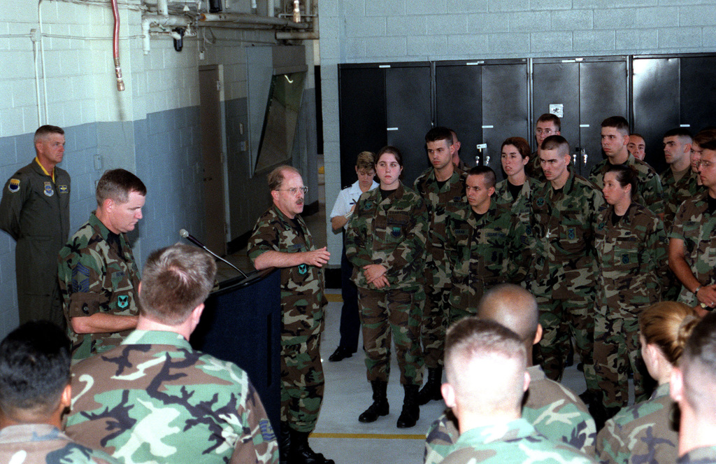 Secretary of the Air Force (SECAF), The Honorable F. Whitten Peters (leaning on podium) and CHIEF MASTER Sergeant of the Air Force (CMSAF), Eric W. Benken, (left of the podium) discuss manning and retention problems with USAF Security, Air Traffic Control and Fire Department Personnel from Pope AFB, North Carolina