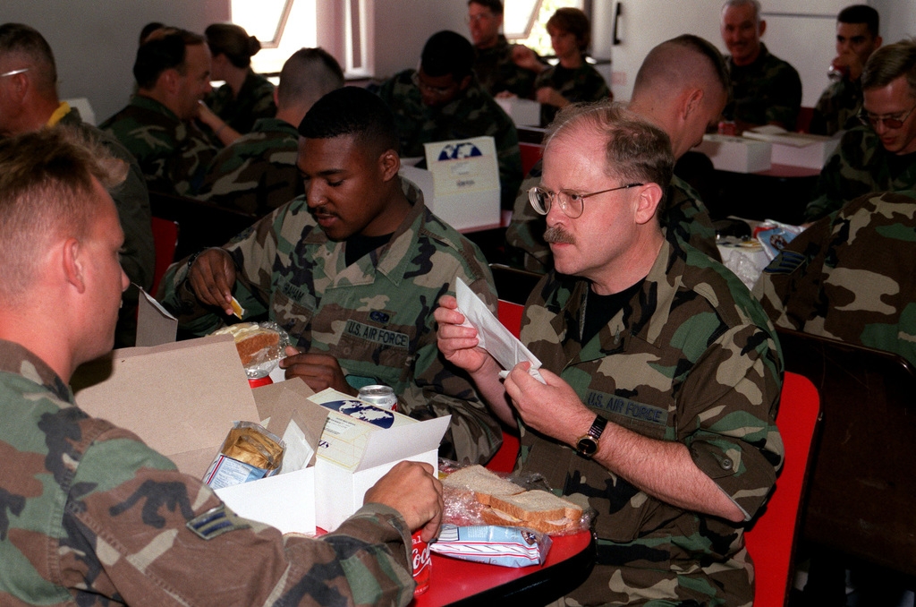 Secretary of the Air Force (SECAF), The Honorable F. Whitten Peters shares a box lunch with USAF Maintenance personnel from the 75th Fighter Squadron, 23rd Fighter Group, Pope AFB, North Carolina