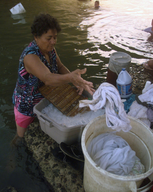 A local Fajardo, Puerto Rico resident washes clothing in the town's river. Her and the other residents of Fajardo have been without electricity for two days. The local population currently uses the river to bathe and wash clothing. Hurricane George winds caused devastating damage to homes and property though out Puerto Rico and other neighboring Caribbean Islands