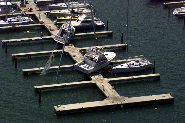 Boats at Marina del Rey were literally lifted from their dock slips during Hurricane George's rampage last Monday. Hurricane George winds caused devastating damage to homes and property though out Puerto Rico and other neighboring Caribbean Islands