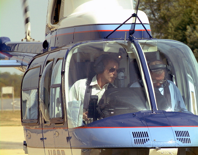 Harrison Ford arrives in a helicopter he just piloted to Naval Air Sation (NAS) Patuxent River, Maryland, the location of his current movie project Random Hearts. Three scenes were filmed in a hangar on NAS Patuxent River and involved many active duty personnel as extras