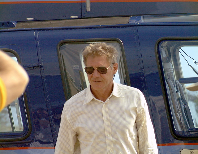 Harrison Ford exits the helicopter he just piloted to Naval Air Sation (NAS) Patuxent River, Maryland, the location of his current movie project Random Hearts. Three scenes were filmed in a hangar on NAS Patuxent River and involved many active duty personnel as extras