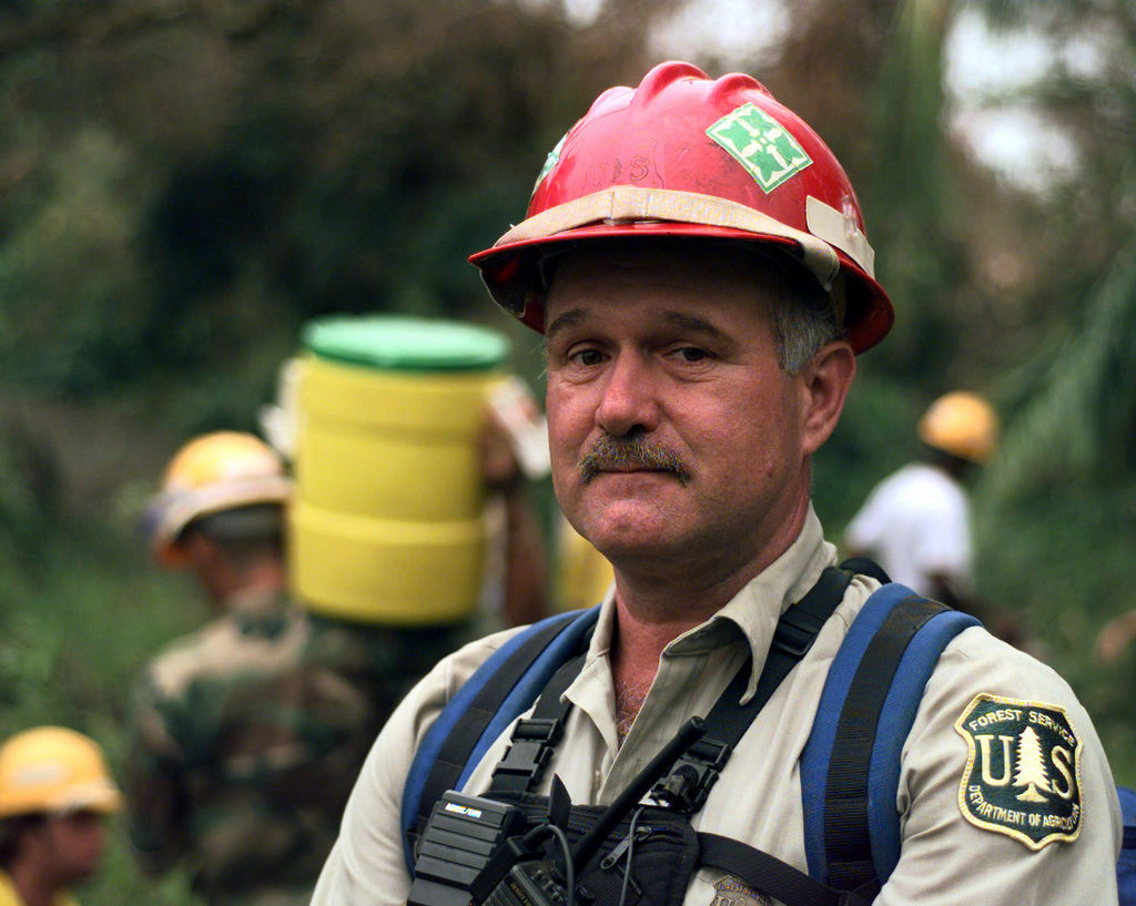 Dennis Daniels, National Forest Service, is in charge of a team of local volunteers tasked to clear fallen trees, downed power lines and other debris from the roads in Puerto Rico's Caribbean National Forrest (CNF). The CNF houses one of the Island's major telecommunications facilities. The devastating winds of Hurricane George ripped through the Island leaving it without electrical power, potable water and phone communications