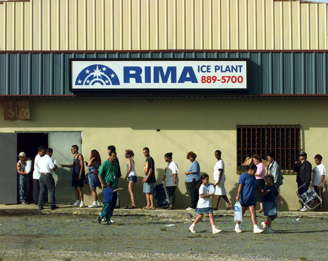 Just outside the town of Fajardo, Puerto Rico, people wait in line to buy a single bag of ice. The demand for ice is so great that the owner of the factory has limited the sale of ice to one bag per person. The Rima ice factory is one of three in the local area currently working with the Federal Emergency Management Agency (FEMA) to provide ice to the local communities. The devastating winds of Hurricane George ripped through the Island leaving it without electrical power, potable water and phone communications