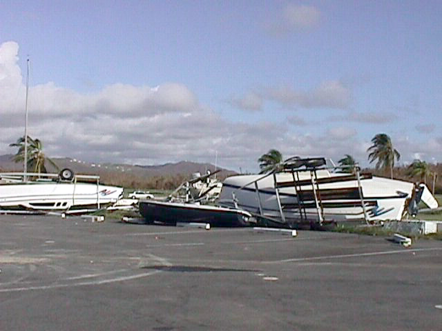 With sustained 135-mph winds, Hurricane Georges tore through Puerto Rico leaving a wake of over turned boats at Naval Station Roosevelt Roads marina