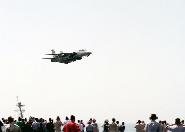 Captain Thomas Kilcline, Jr., breaks the sound barrier, October 01, 1998, during a supersonic flyby over the aircraft carrier USS ABRAHAM LINCOLN (CVN 72) in an F-14D Tomcat assigned to Fighter Squadron 31 (VF-31) Tomcatters. LINCOLN is currently deployed to the Persian Gulf in support of Operation SOUTHERN WATCH