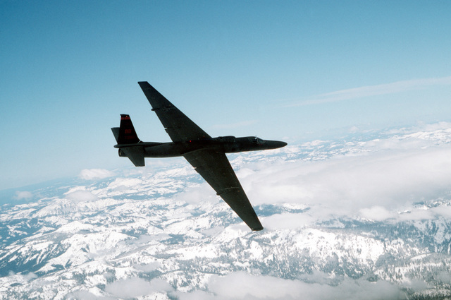 """Over Northern California. A U-2 """"Dragon Lady"""" high-altitude reconnaissance aircraft from Beale, Air Force Base, California, flies a training mission over northern California. U-2s are based at Beale, and the unit has four operational detachments worldwide. The U-2 provides continuous day or night, all-weather surveillance suporting US and allied ground and air forces. When requested, the U-2 also provides photographs to the Federal Emergency management Agency during disaster relief"""