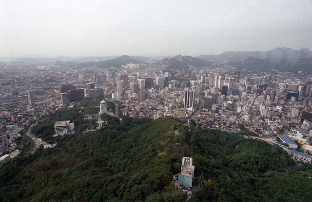 On the way to the Seoul Tower in Seoul, Republic of Korea, roofs of more traditional buildings are backed by spectacular highrise buildings in the fourth largest city in the world, Oct. 5,1998. The Seoul Tower is one of the most popular tourist attractions in the Republic of Korea