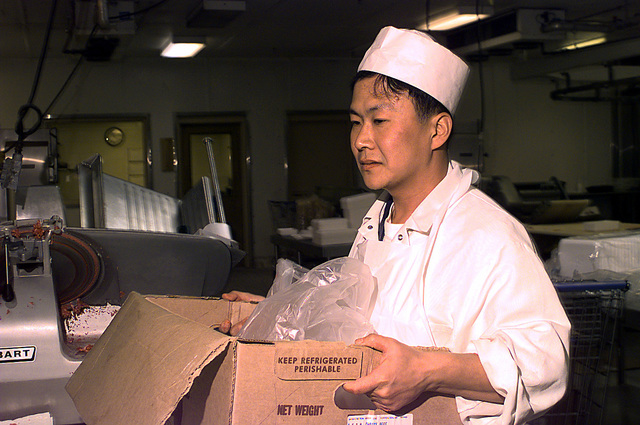 A meat cutter carries freshly cut beef for packaging and consumer sale at the Yongsan Commissary, Yongsan Army Garrison, Seoul, Korea, on Oct. 8, 1998. The Commissary supports thousands of U.S. service members, their dependents and Department of Defense employees from Yongsan Garrison and smaller posts in and around the city of Seoul