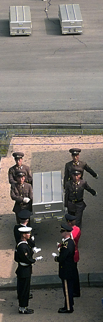 North Korean soldiers carry a casket that will be passed across the Military Demarkation Line (MDL) to the U.N. Command Honor Guard soldiers during a repatriation ceremony. During the ceremony the remains of what is believed to be five U.S. soldiers that served in the Korean war were returned to the South. During the ceremony the reamains are passed across the MDL from North Korean soldiers to a group of United Nations Command Honor Guard soldiers. As the remains are passed across the MDL they are saluted by a delegation of representing members of the U.S. Veterans of Foreign Wars, some of which served in the Korean War. A spokesman for the U.N. Command, said that the remains were...