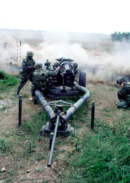 Red Legs from the 320th Field Artillery fire downrange with their 105mm howitzer during a field exercise