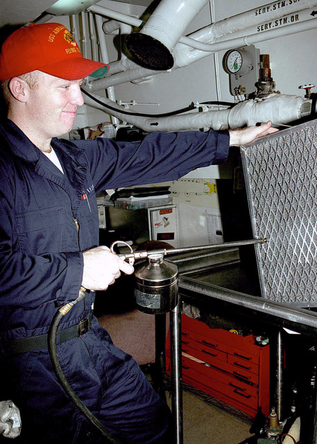 Damage Controlman Second Class Chris D. Guelke a member of the Flying Squad on board USS ABRAHAM LINCOLN (CVN 72), stores ventilation filters after cleaning them in the Filter Cleaning Shop. The Abraham Lincoln Battle Group is currently forward deployed to the Persian Gulf in support of United Nations sanctions against Iraq during Operation SOUTHERN WATCH