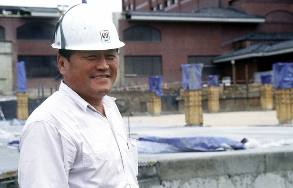 This Korean foreman supervises construction at the Dragon Hill Lodge, Yongsan South Army Post, Seoul, Korea on Oct. 13, 1998. The expansion will include 99 rooms and over 200 parking spots in a multi-level parking garage